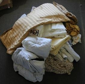 THREE BAGS OF ASSORTED TOWELS AND TEXTILES