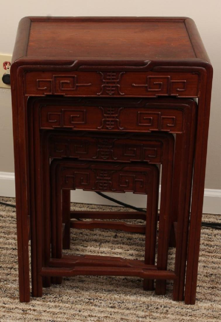 SET OF FOUR CHINESE WOODEN NESTING TABLES