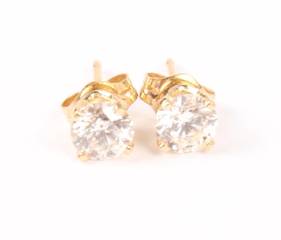 PAIR OF 14K GOLD DIAMOND STUD EARRINGS