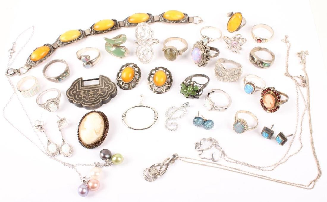 ASSORTED SILVER JEWELRY : BRACELETS, RINGS, & MORE