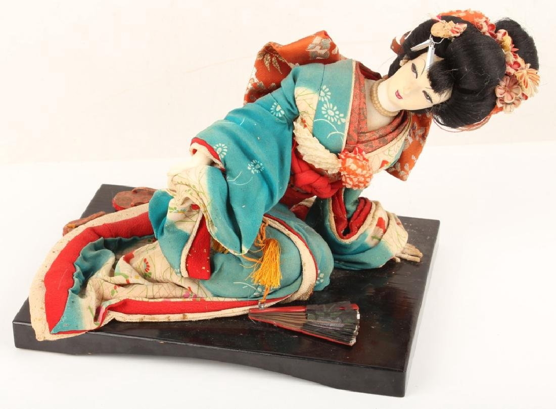 JAPANESE GEISHA DOLL RECLINED BLACK WOOD BASE