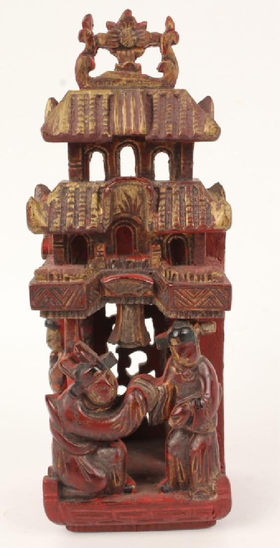CHINESE RED CARVED WOODEN FIGURINE