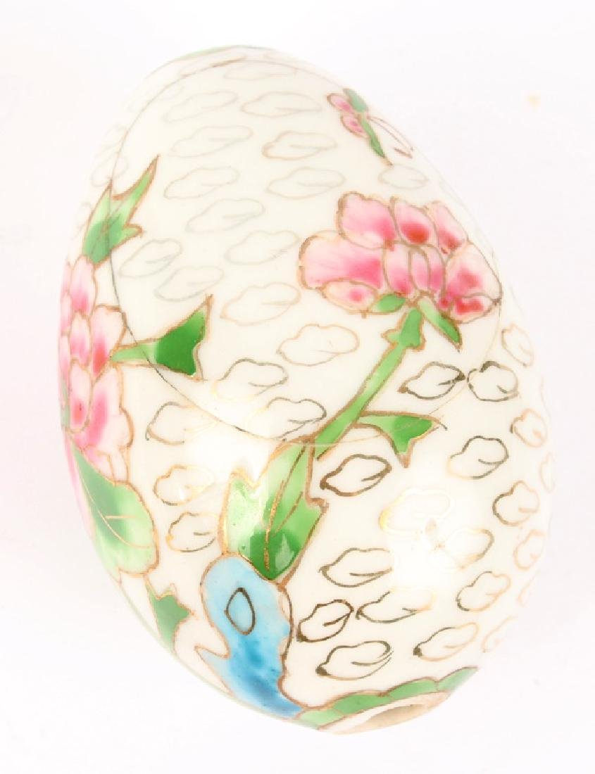 PAINTED WHITE FLORAL PORCELAIN EGG