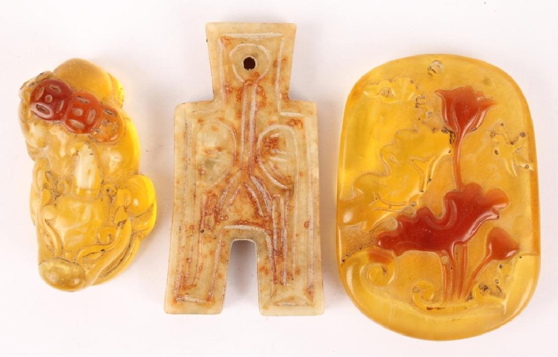 CHINESE AMBER AND SOFT STONE PENDANTS