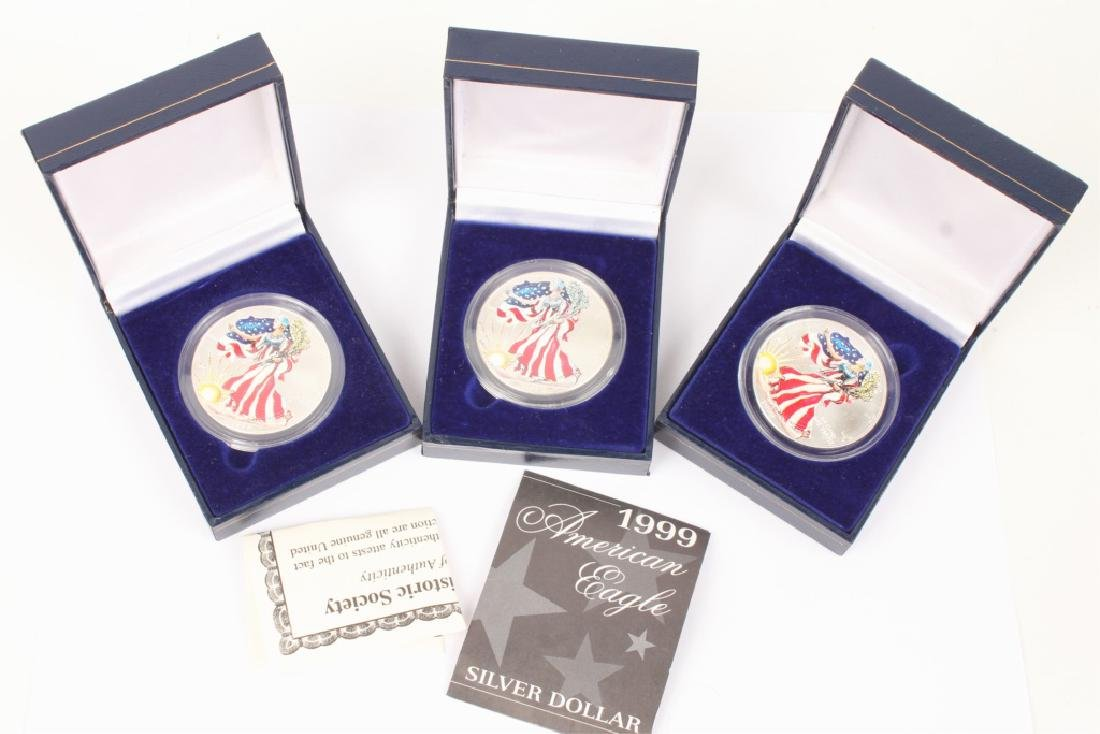 LOT OF 3 PAINTED 1999 AMERICAN SILVER EAGLES
