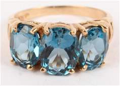 LADIES 10K YELLOW GOLD BLUE COLORED STONE RING