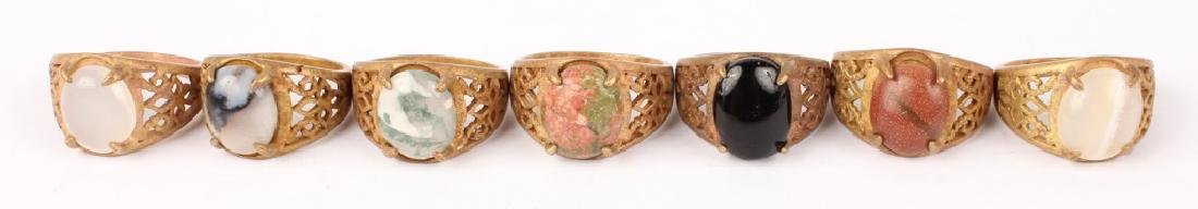 CARVED CHINESE SOFT STONE RINGS WITH INSET STONE