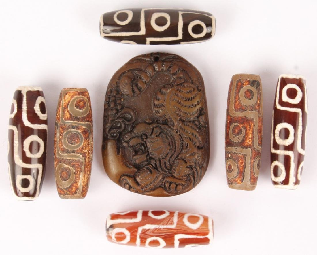 SIX CARVED STONE BEADS & TIGER SOFT STONE PENDANT
