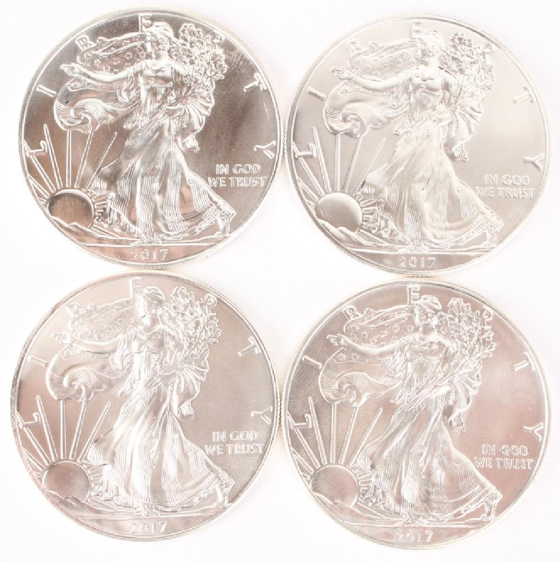 (4) AMERICAN SILVER EAGLE ONE OUNCE SILVER COINS