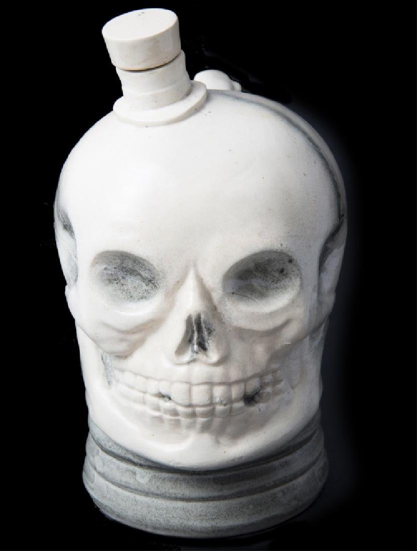 SWISS SKULL DRINKING CONTAINER WIND UP MUSIC BOX