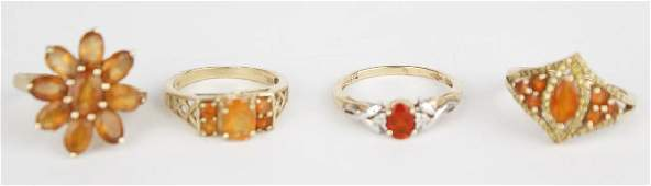 10K YELLOW GOLD AND GEMSTONE RINGS - LOT OF 4