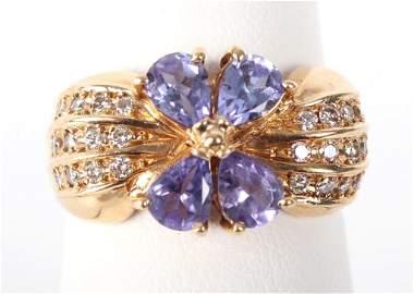 14K GOLD PURPLE TANZANITE DIAMOND RING - 0.06 CTW