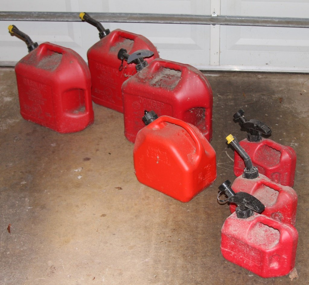 LOT OF 7 RED PLASTIC GASOLINE CANISTERS