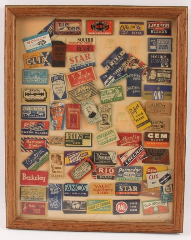 FRAMED GROUPING OF SAFETY RAZOR BLADE PACKETS