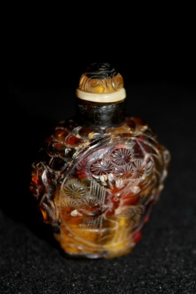 Qing Highly Carved Amber Snuff Bottle