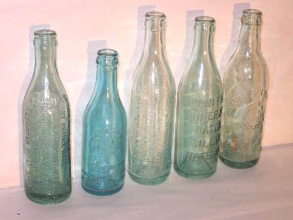 128: FIVE EARLY CANADIAN  BOTTLES