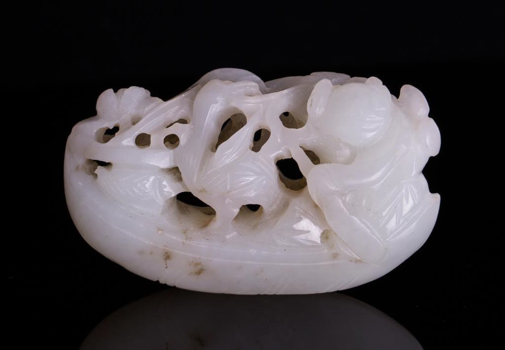 WHITE JADE TOGGLE CARVED BOY ON BOAT