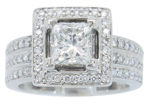 HIGHLY DETAILED CERTIFIED DIAMOND 18K HALO RING