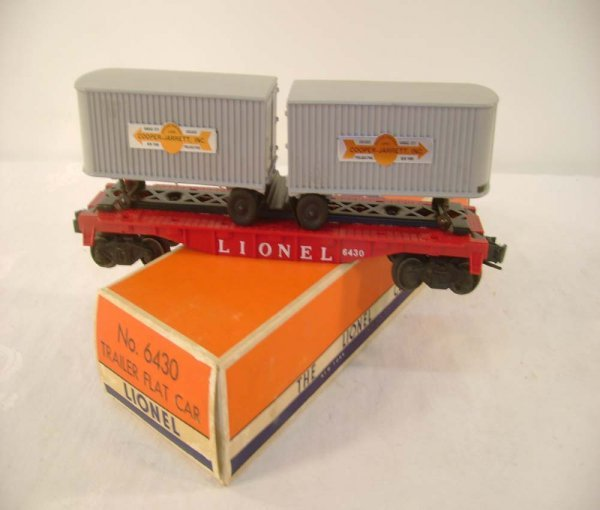 418: ABT: Lionel #6430 Flat Car with CJ Trailers/OB