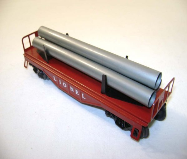 502: ABT: Rare Lionel #6121-85 Maroon Flat Car w/Pipes