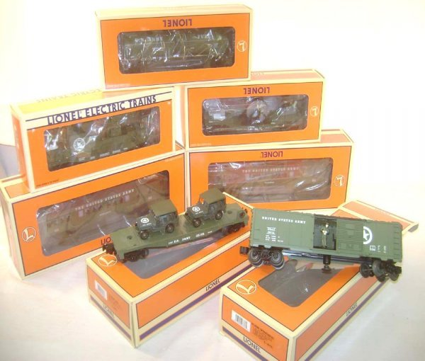 24: ABT: 7 Mint Lionel Assorted US Army Cars/OBs