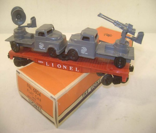 24: ABT: Exceptional Lionel #6804 USMC Flat Car with AA