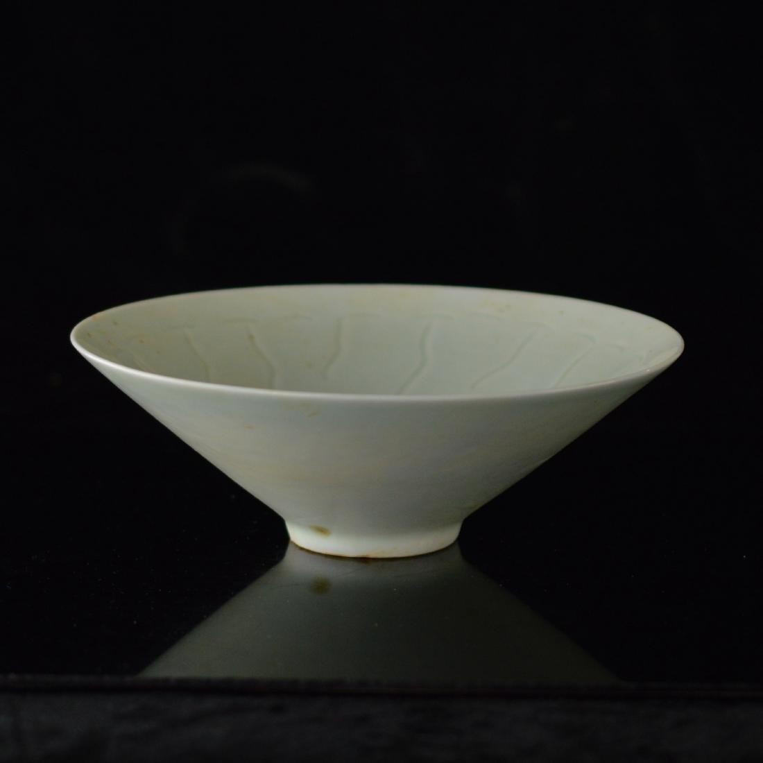 Lotus carved Douli porcelain bowl
