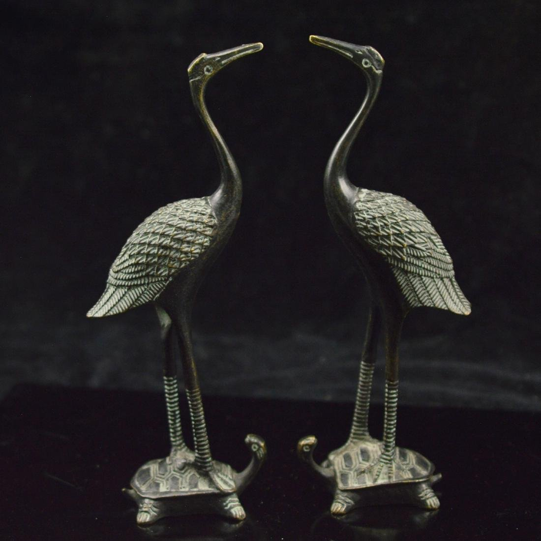 Pair of bronze crane