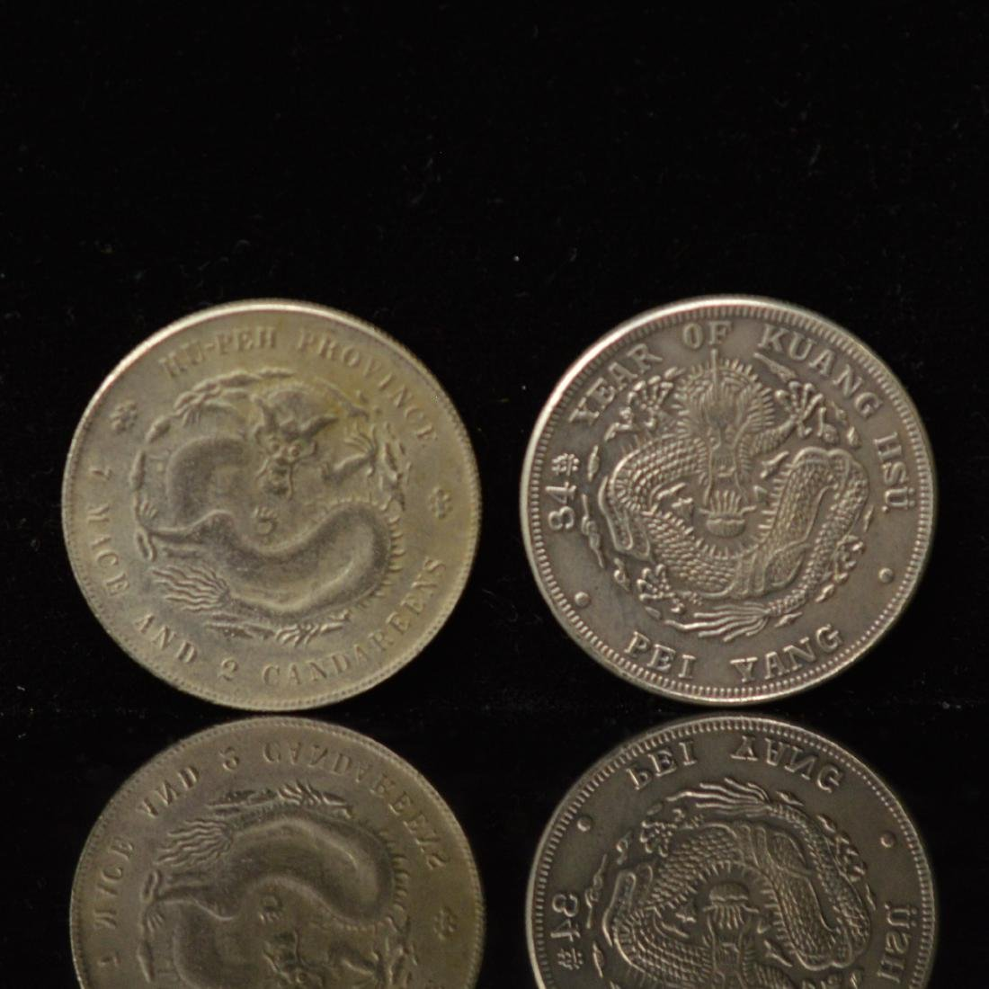 Two 34years of Kuang Hsu Silver coins