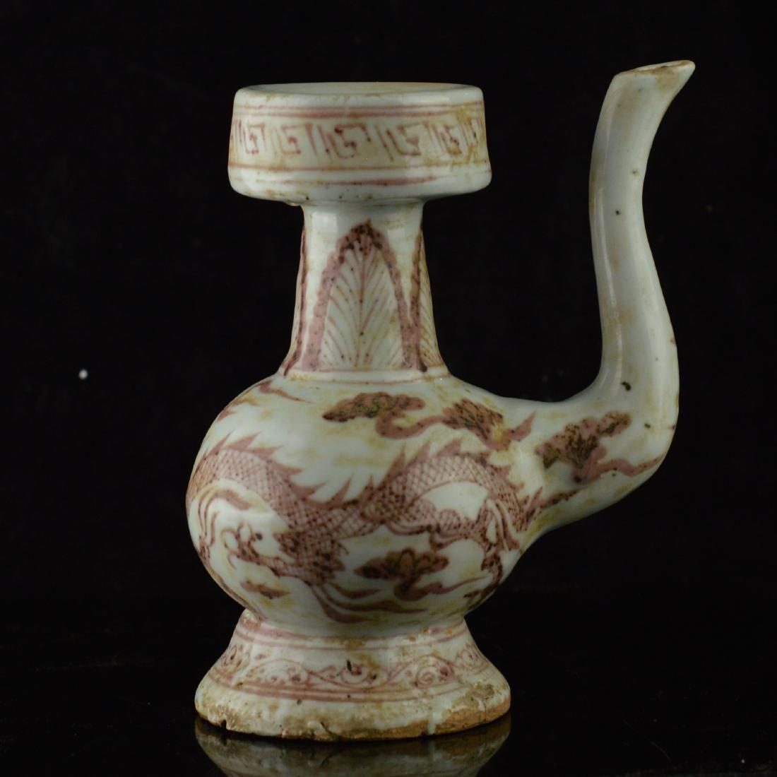 Red glazed triple dragon porcelain pot