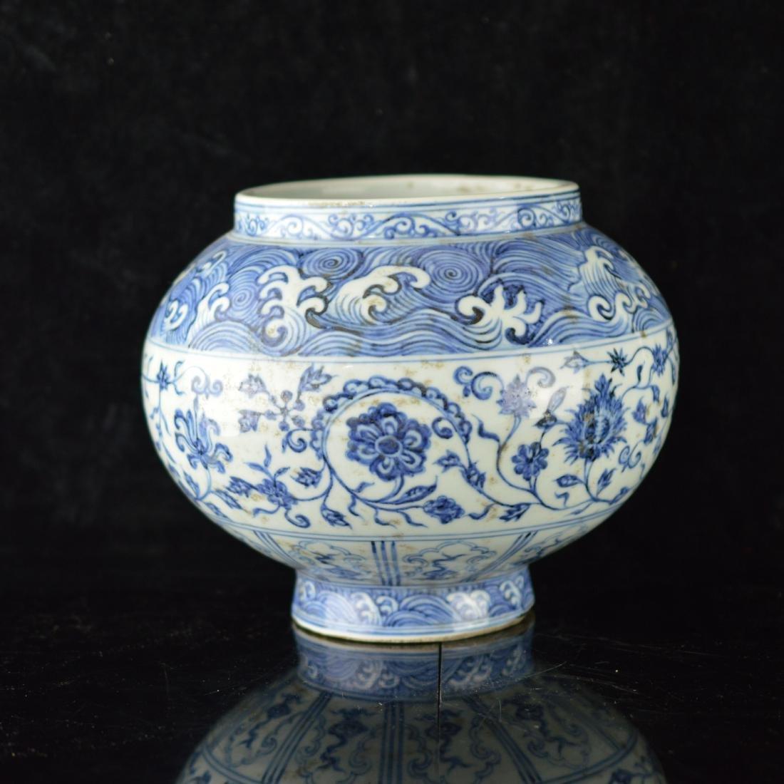 Blue and white flower jar
