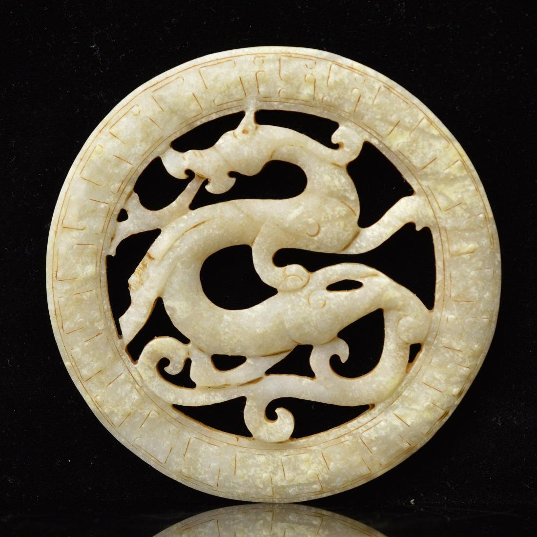 Jade carved dragon pendant