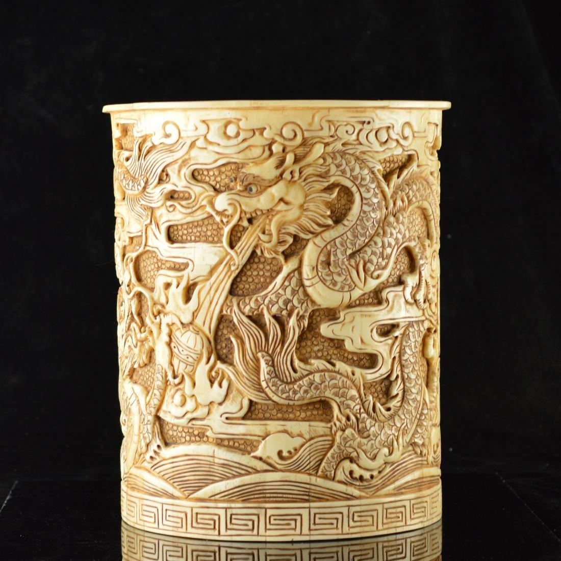 Bone crafted dragon brush holder