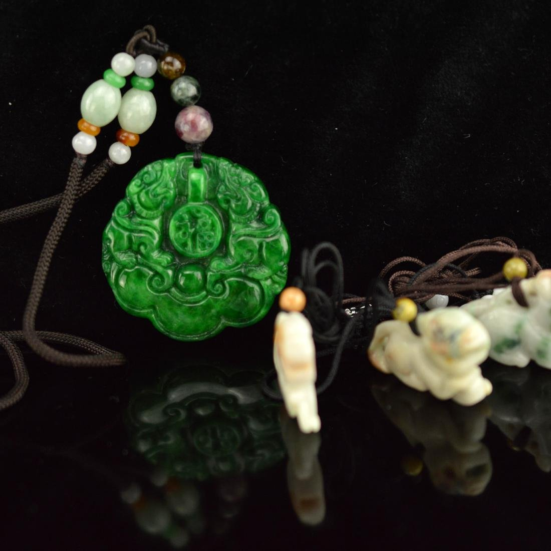 Four jadeite pendants