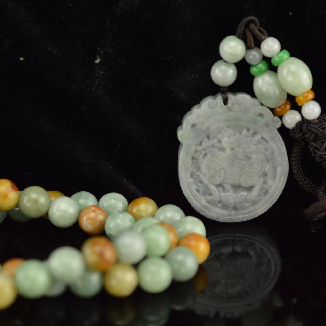 Jade pendant and two jadeite bracelet