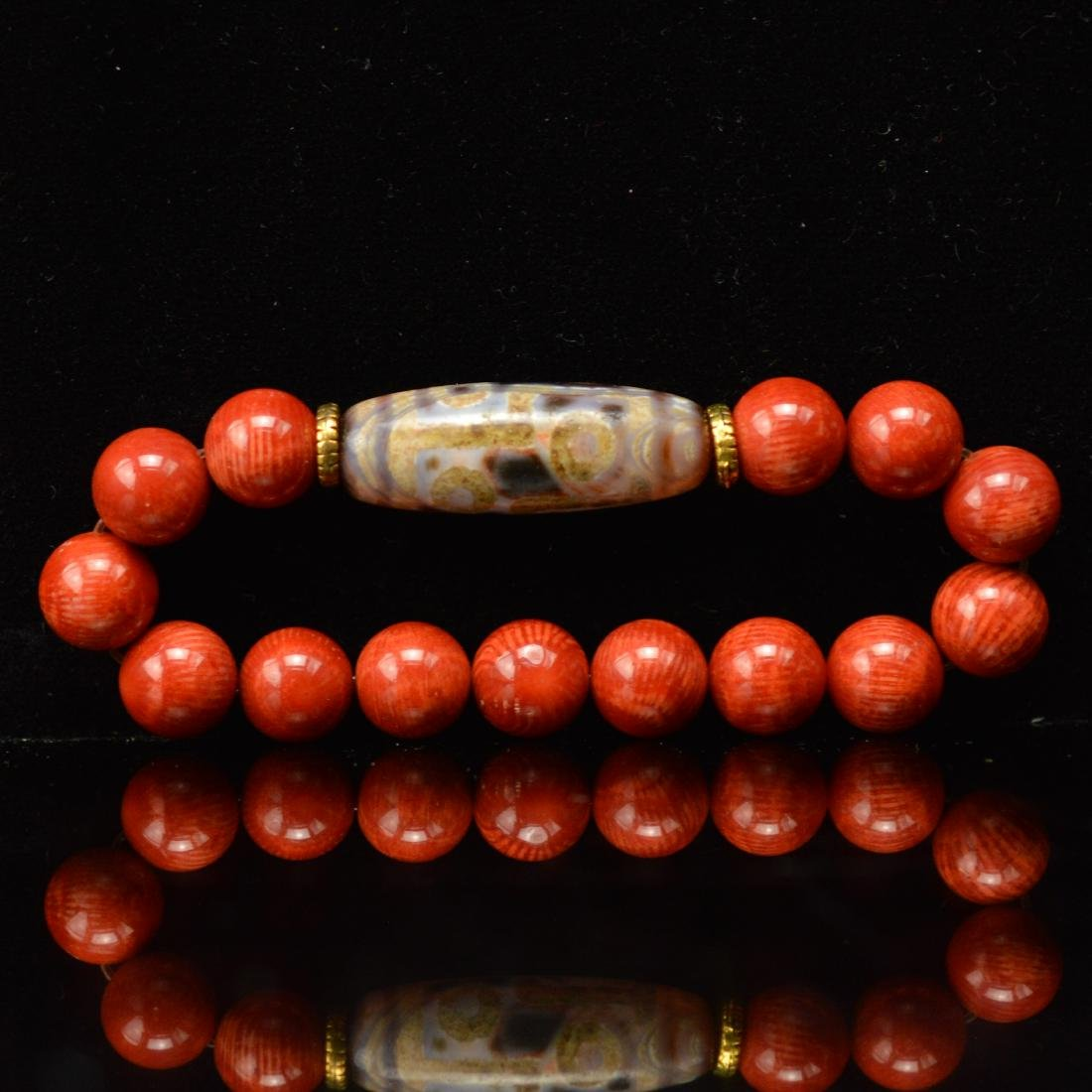 Red coral and six eyes Dzi bracelet