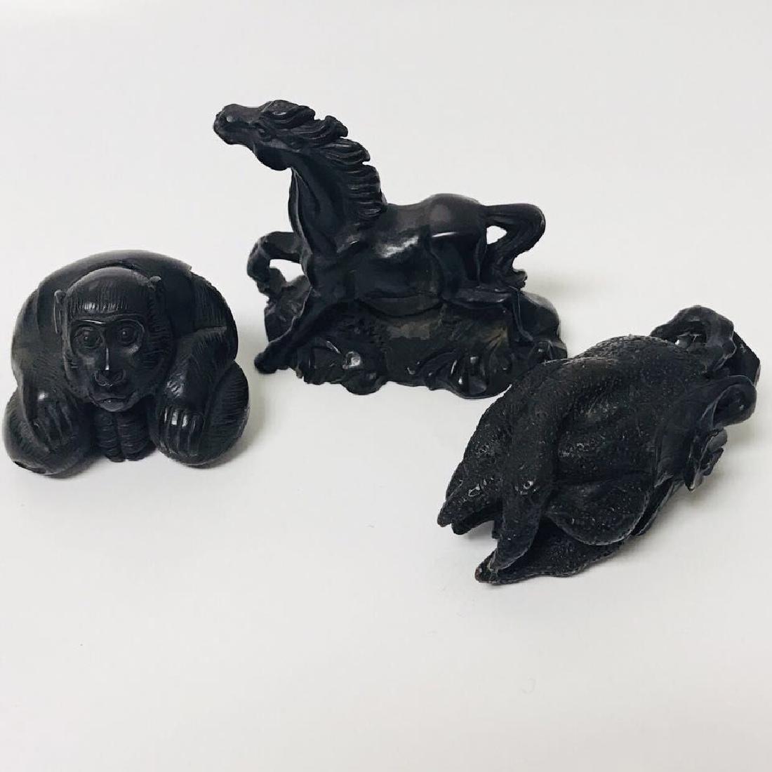 Three old NETSUKE: Buddha hand; horse; monkey