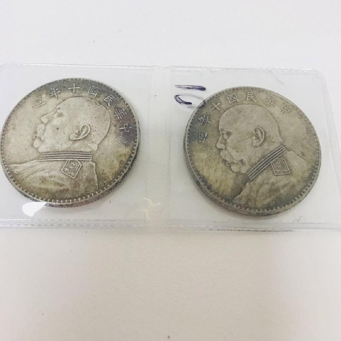 Pair of Big Head Yuan Silver Coins