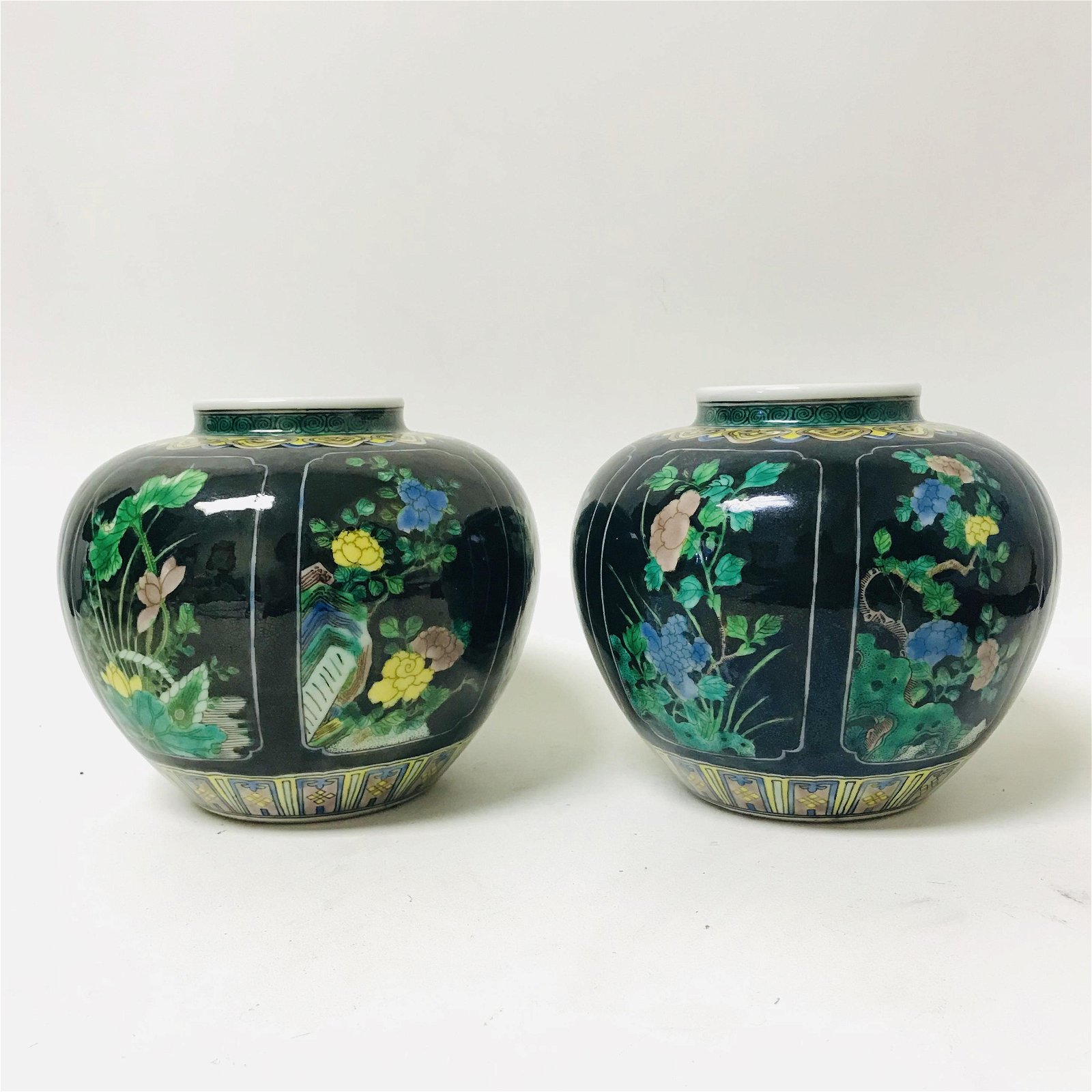 A pair of 19th century black ground multicolored