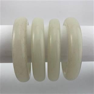 A Set of Four Natural Hetian Jade Bangles