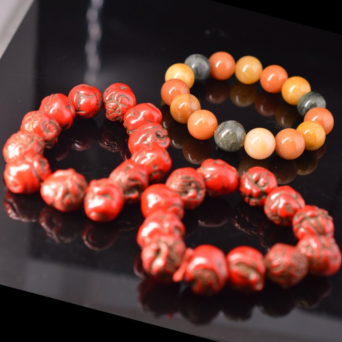 Pair of Cinnabar Lacquer Bead Carved Bracelets +