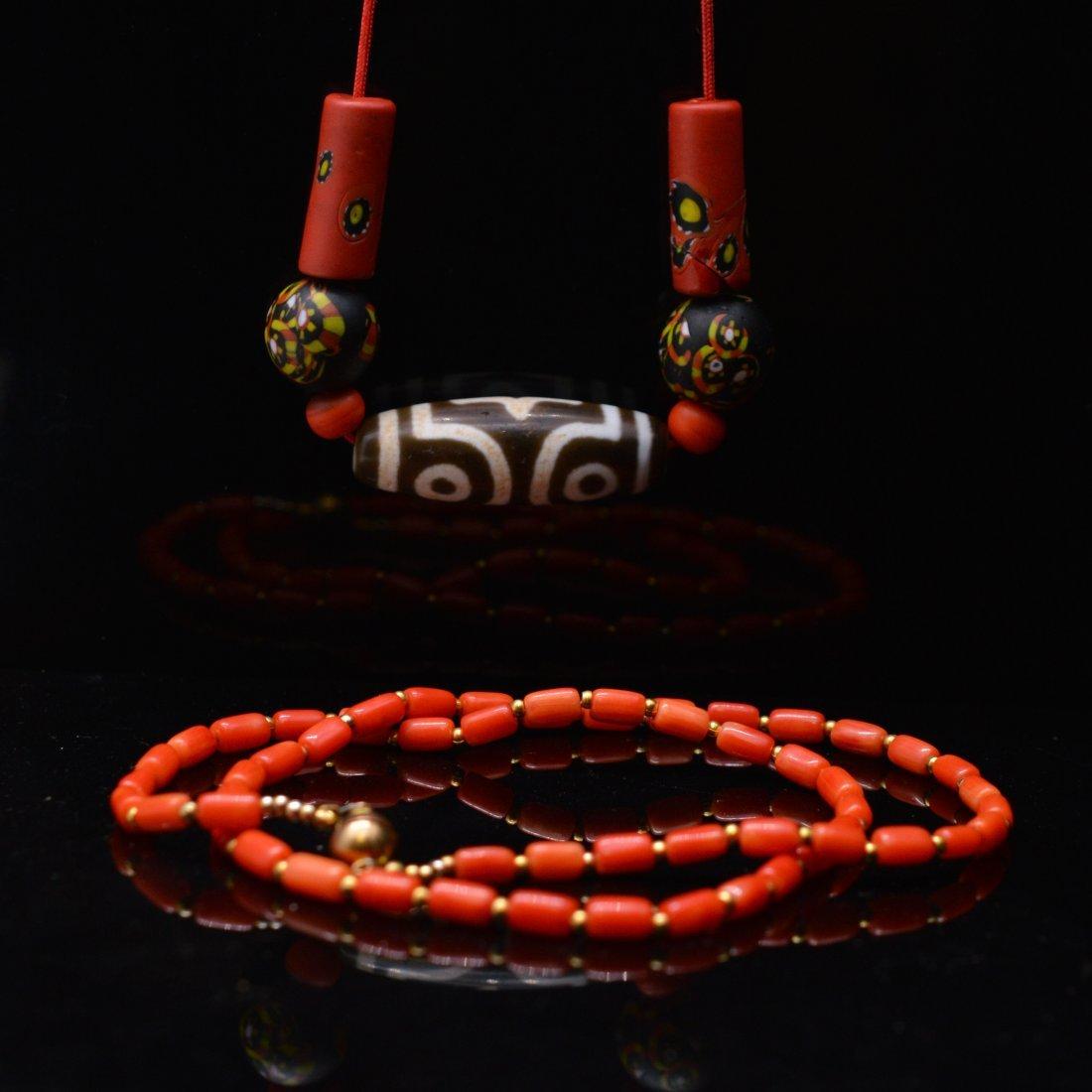 Three-Eyed Dzi Bead Necklace + Coral Necklace