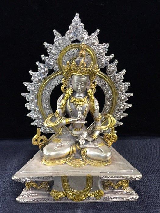 A Finely Carved Antique Bronze Tibetan Buddha