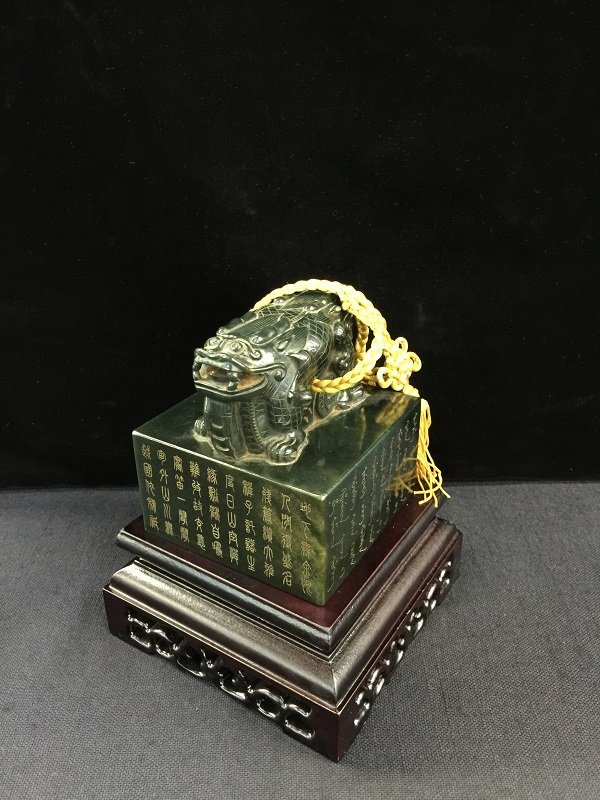 A Finely Carved Qing Spinach Jade Emperor Stamp