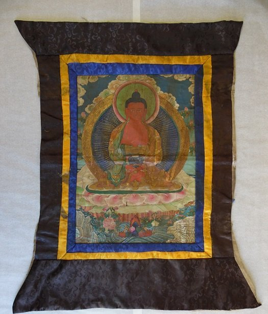 A Tibetan Thangka With Silk Embroidered Framing