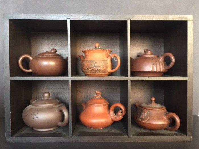6 Pieces Of Zisha Tea Pot On Wood Shelf