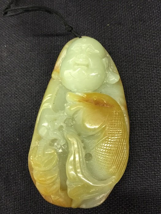A Nicely Carved Jade Buddha Holds Fish