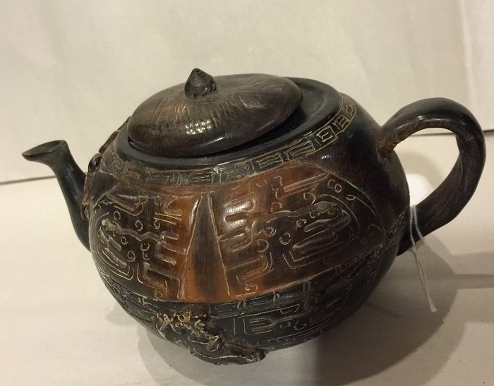 A Finely Carved Antique Horn Tea Pot With Motifs