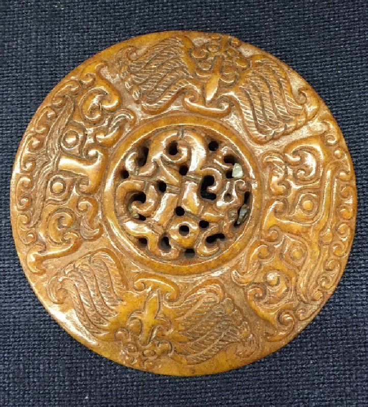 A Finely Carved Antique Jade Pendant