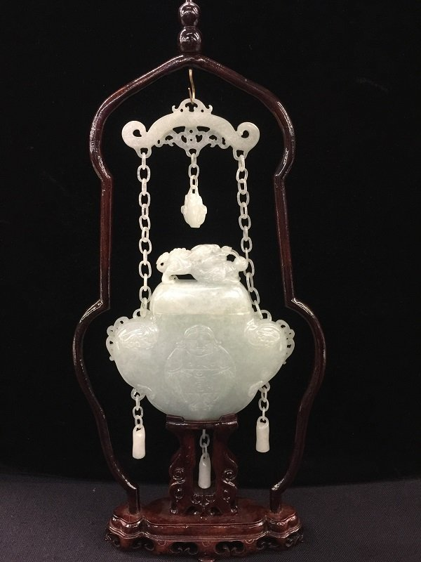 A Qing Carved White Jadeit Vase With Frame.